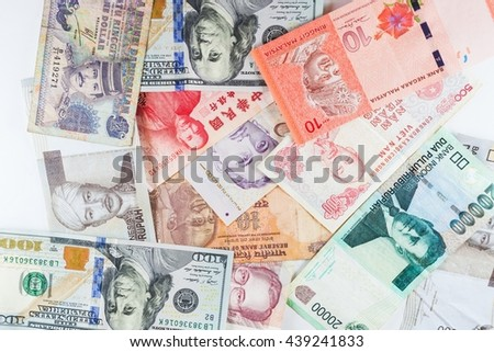 Multiple Currencies banknotes as colorful background showed the global money financial business economy crisis - stock photo
