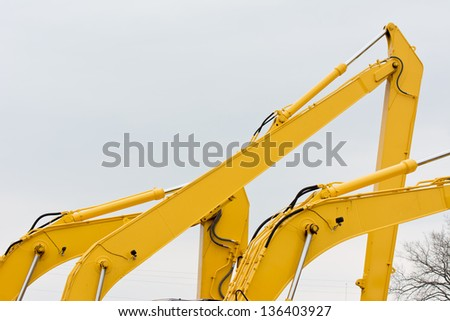 Multiple Excavator Boom Arms on Construction Equipment - stock photo