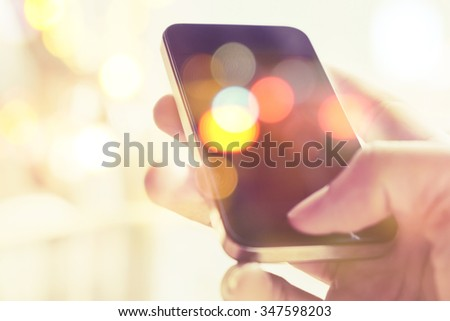 Multiple exposure of smart phone and Bokeh  - stock photo