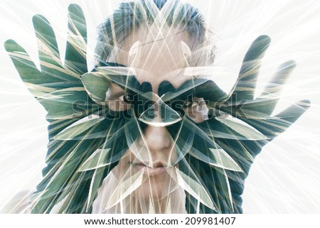 Multiple exposure portrait of attractive woman in black gloves forming glasses combined with photograph of cactus - stock photo