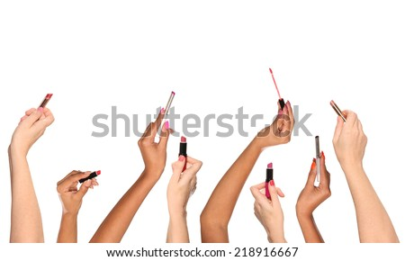 Multiple hands applying lip color - stock photo