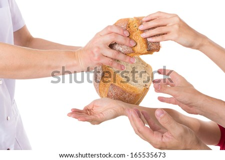 Multiple hands grabbing for food - stock photo