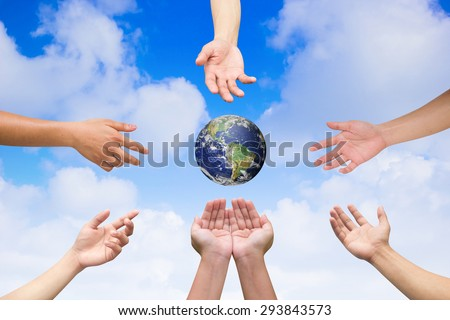 multiple hands reaching the world for heal together, save the world concept ,Elements of this image furnished by NASA - stock photo