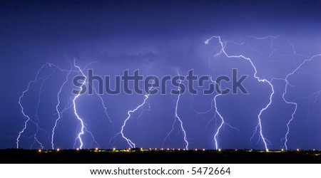 Multiple lightning bolts from an active thundershower - stock photo