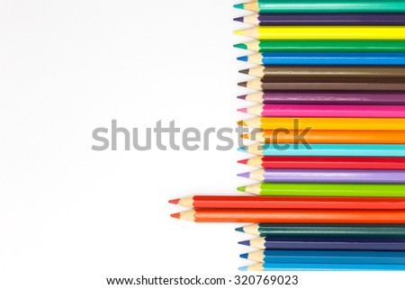 Multiple of wooden colour pencils on white background - stock photo