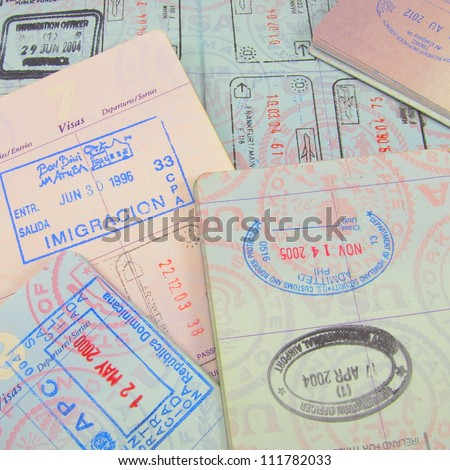 Multiple passports and passport stamps - stock photo