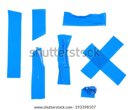 Multiple pieces of blue insulating tape of different shapes, isolated over the white background - stock photo