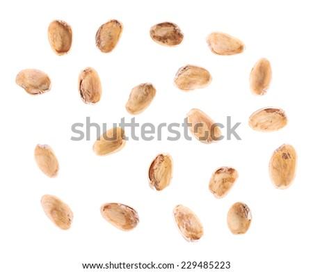 Multiple pistachio shells isolated over the white background - stock photo