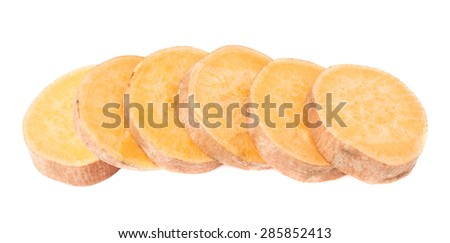 Multiple slice sections of the sweet potato or Ipomoea batatas aligned in a line, composition isolated over the white background - stock photo
