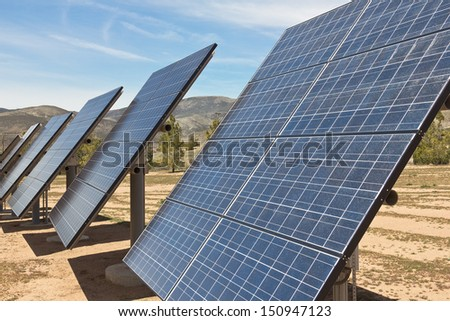 Multiple solar panels used in a rural area.  - stock photo