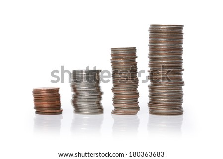 Multiple stacks of American coins on white background - stock photo