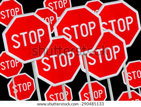 Multiple stop sign against black background  - stock photo