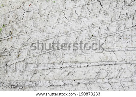 Multiple Truck Tire Tracks in Grey Mud - stock photo