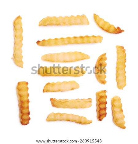 Multiple yellow oil fried single wavy french fries isolatedwavy french fries - stock photo