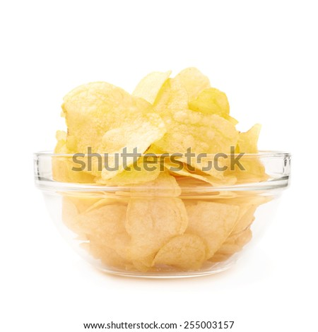 Multiple yellow potato chips snacks in a glass bowl, composition isolated over the white background - stock photo