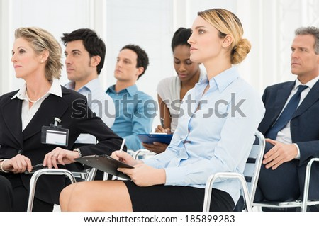 Multiracial Businesspeople Attending A Seminar Together - stock photo