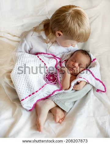 Multiracial family concept. White brother and black newborn sister. - stock photo