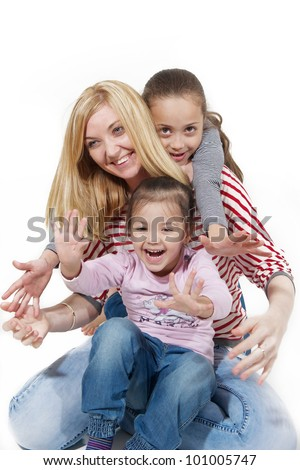 multiracial family of mother and daughters - stock photo