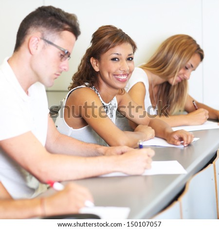 multiracial female student smiling at the university - stock photo