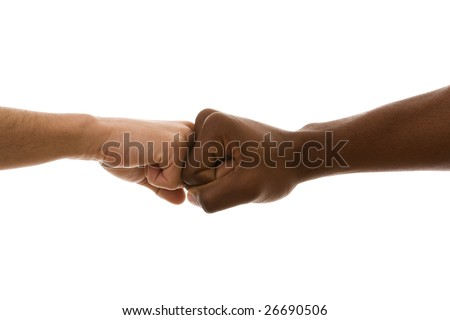 multiracial fist to fist agreement (isolated on white) - stock photo