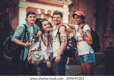 Multiracial friends tourists making selfie in an old city  - stock photo