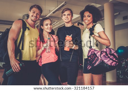 Multiracial group after aerobics class - stock photo