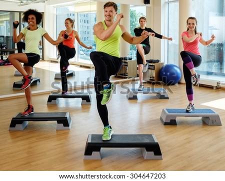 Multiracial group during aerobics class - stock photo
