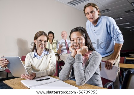 Multiracial group of college students and teacher in class - stock photo