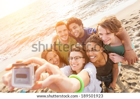 Multiracial Group of Friends Taking Selfie at Beach - stock photo