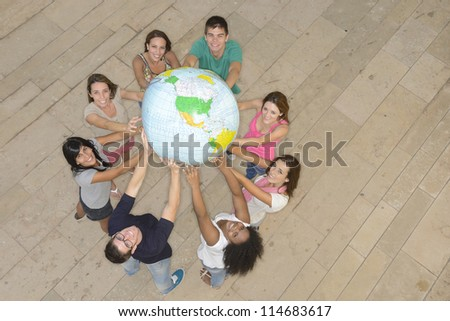 Multiracial group of people holding  the Earth Globe showing America - stock photo