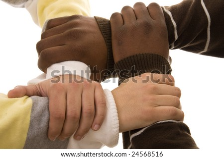 Multiracial hands holding each other isolated on white - stock photo