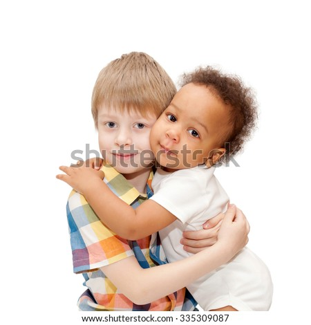 Multiracial happy family. White brother hugging black baby sister. - stock photo