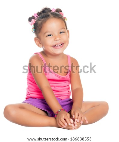 Multiracial small girl laughing sitting on the floor (isolated on white) - stock photo