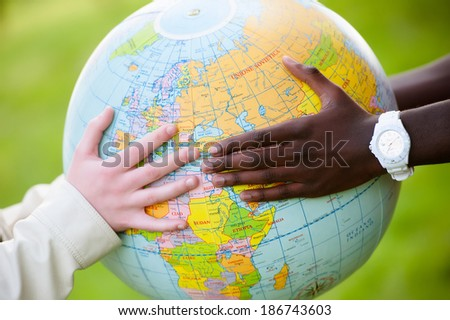 Multiracial Teen Couple Holding Globe Map - stock stock - stock photo