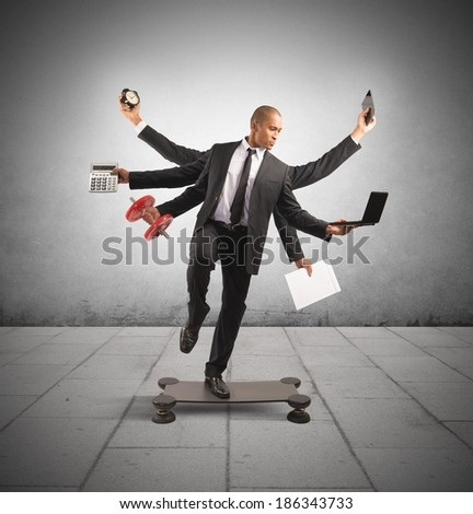 Multitasking concept with businessman at work doing gymnastics - stock photo
