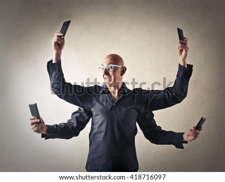 Multitasking man - stock photo