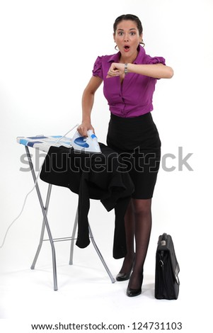 Multitasking woman looking at the time - stock photo