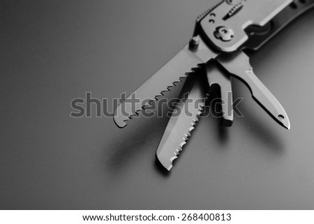 Multitool knife - stock photo