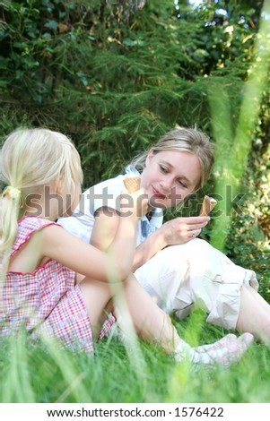 Mum and daughter in the park - stock photo
