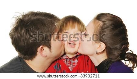Mum and the daddy kiss the son. It is isolated on a white background - stock photo