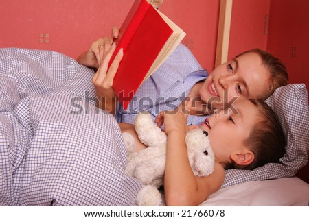 Mum puts to bed a sonny 7 - stock photo