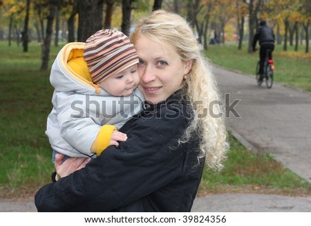 Mum with kid in park - stock photo