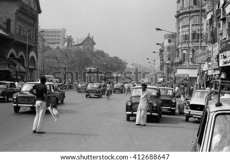 MUMBAI, INDIA - FEBRUARY 15, 1984: traffic and pedestrian in one of the city main street. The place is every day extremely crowded. - stock photo