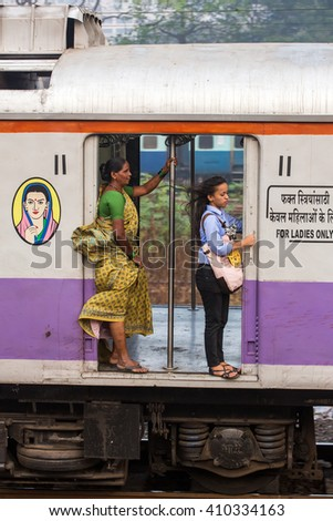 Mumbai, India - February 29, 2016: Unidentified women traveling via Suburban train in ladies only carriage in Mumbai, India.  - stock photo