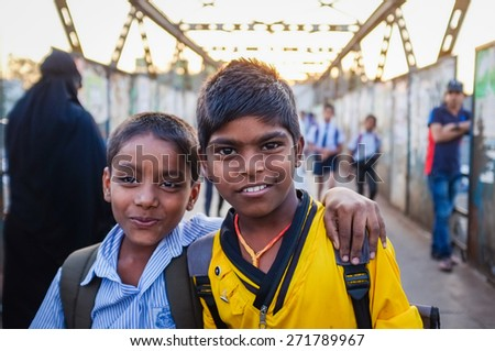 MUMBAI, INDIA - 12 JANUARY 2015: Indian school boys in Dharavi slum - stock photo