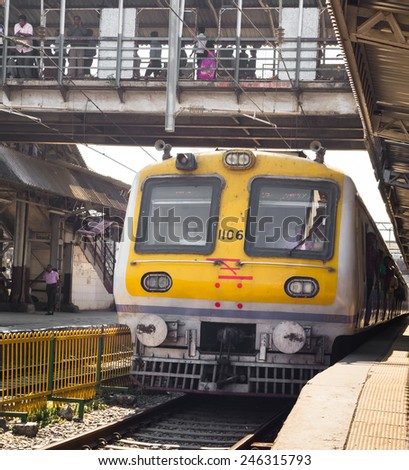 MUMBAI, INDIA - SEPTEMBER 12: Suberban train pulling on Mumbai Central station on September 12, 2013 in Mumbai, India. Mumbai Suburban Railway carries more than 7 million commuters on a daily basis. - stock photo