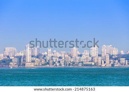 Mumbai skyline view from Marine Drive in Mumbai, India - stock photo