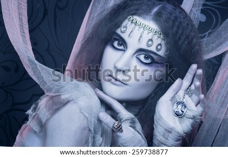 Mummy. Young woman in creative theatrical image and with artistic visage. - stock photo
