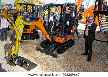 Munich, April 13, 2016: Engeneer of Hitachi CE report about mini excavator Zaxis 19-5 at bauma Munich 2016 - stock photo