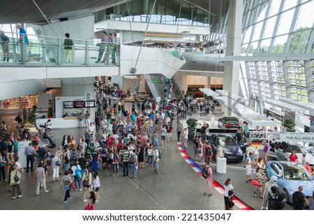 MUNICH, CIRCA AUGUST 2014: BMW WELT was constructed from August 2003 through summer 2007 at a cost of US$200 million.The number of visitors increased to 2,930,000 circa August 2014 in Munich - stock photo